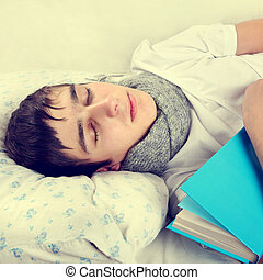 Man sleep with a Book - Toned Photo of Tired Young Man Sleep...