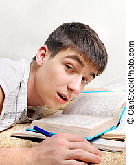 Tired Student on Sofa - Tired Young Man on the Sofa with the...