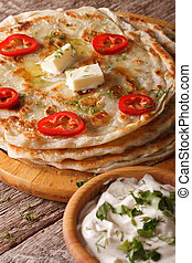Indian food: hot paratha with butter close-up. vertical -...