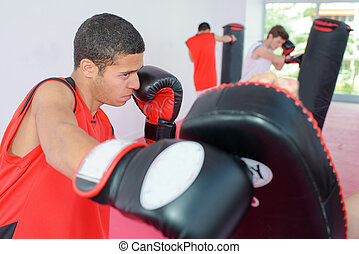 Young man in boxing training