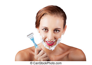 Funny portrait of a woman shaving face with razor - Young...