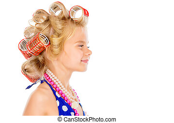 hair curlers - Funny little girl in her mothers hair curlers...