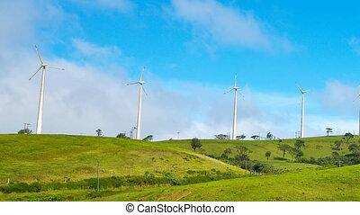 Wind turbines on green hill