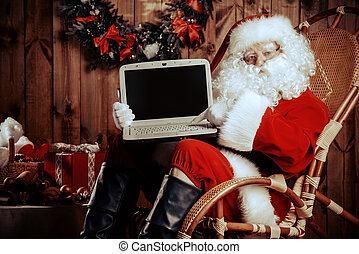 shoping santa - Modern Santa Claus at his wooden house...