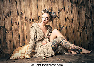 tenderness - Beautiful young woman with dreadlocks hairstyle...