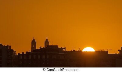 Sunrise over roofs of Porto from bridge at Douro river...