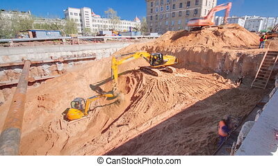 Yellow excavators at Construction of a new circular metro...