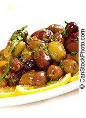 Olives drizzled with olive oil and chilli flakes