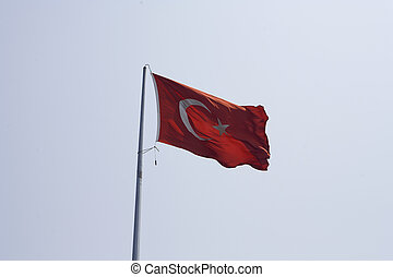 Turkish Flag - A turkish flag on a pole moves in the wind in...