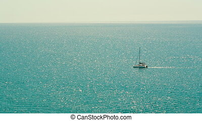 Yacht in the Ocean - lone boat in the ocean
