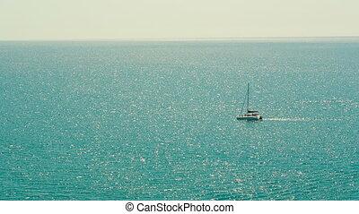 Yacht in the Ocean - lone boat in the ocean