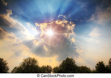 Divine light shines through the clouds with crepuscular rays