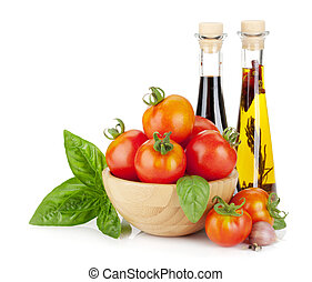 Ripe tomatoes, basil, olive oil, vinegar Isolated on white...