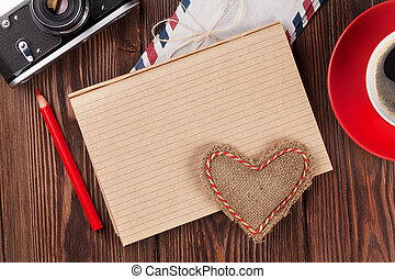 Valentines day heart, camera, coffee and notepad -...