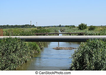 The gas pipeline through the small river
