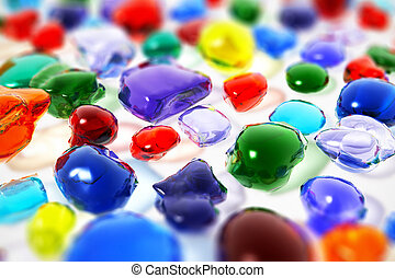 Color gemstones - Macro view of color unfaceted gemstones or...