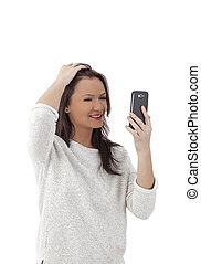 Woman Using a Smartphone Like a Mirror - Young woman using a...