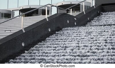 flowing water in stepped fountain with ladder