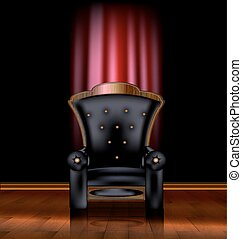 black armchair and red drape - the large black armchair in...