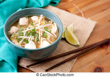 chicken pho soup with noodles bean sprouts and cilantro and...