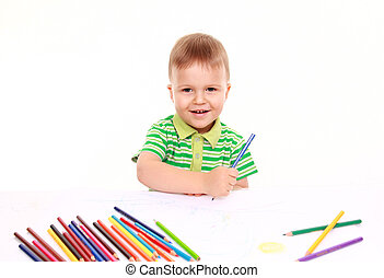Inspired little boy at the table draw with crayons, isolated...