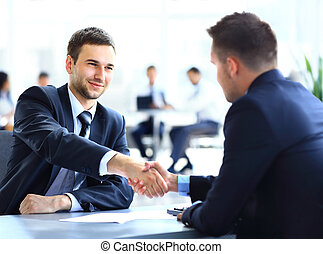 colleagues shaking hands - Two business colleagues shaking...
