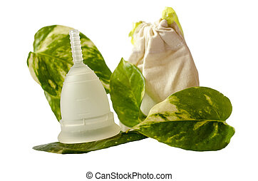 White menstrual cup with green leaves and little beige bag...