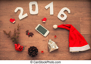 2016 for New Year And Christmas design on wooden table with...