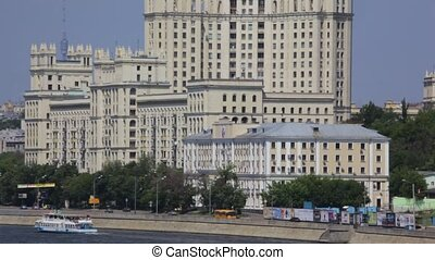 tall soviet residential building on river...