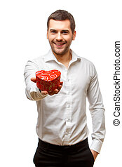 Young man carries heart shaped box - Young man carries a lot...