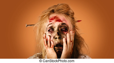 Shocked horror halloween zombie with hands face - Halloween...