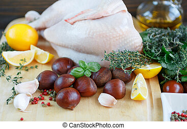 Raw chicken, chestnuts, lemon, herbs and spices. Ingredients...
