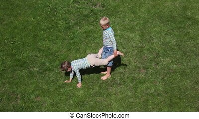 two boys playing wheelbarrow