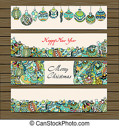Cards with Christmas toys on wooden background