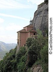 MONTSERRAT, SPAIN - AUGUST 28, 2012: Santa Cova Chapel - Cappella della Santa Grotta at the Benedictine abbey Santa Maria de Montserrat, Spain