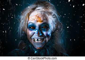 Evil winter monster smiling beneath falling snow - Evil...