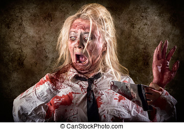 Dead female zombie with saw and amputated hand - Halloween...