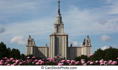 flowers moving with wind in front of Lomonosov Moscow State University
