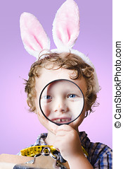 Face of a cute kid on a easter hunt for chocolate - Face of...