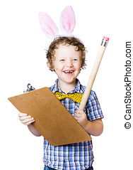 Boy writing Easter list - Happy young boy in rabbit ears...