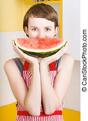 Funny woman with juicy fruit smile - Funny portrait of an...
