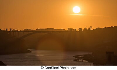 Sunset in Old city Porto at river Duoro,with Port...