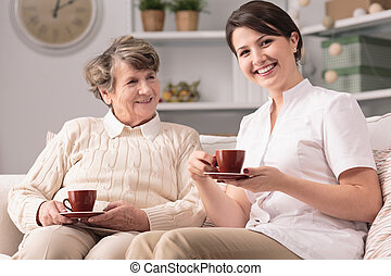 Caregiver and senior female - Image of private caregiver and...