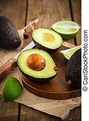 Sliced fresh avocado on cutting board - Sliced fresh avocado...