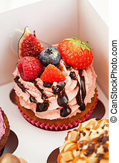 Delicious cupcake decorated with fresh berries
