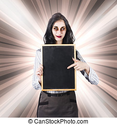 Sinister school teacher holding empty chalk board - Female...