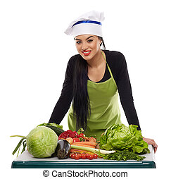 Happy cook with a table of vegetables