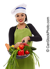 Young latin cook lady with vegetables in frying pan -...