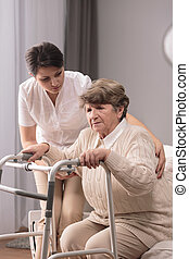 Disabled woman having support - Photo of disabled elderly...