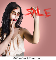 Frightening businesswoman writing sale in blood - Scary...